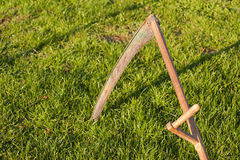 Scythe in grass Stock Images