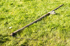 Scythe is old agricultural tools for mowing grass Stock Photos