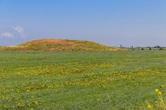 Scythian burial mound in field in the south of Ukraine. Scythian burial mound in a field in the south of Ukraine stock photography