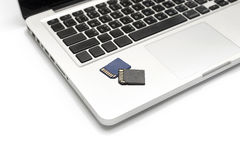 Sd card on laptop Royalty Free Stock Photo