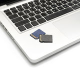 Sd card on laptop Stock Image