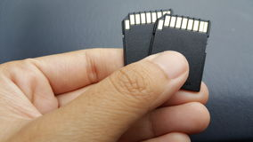 SD card. Memory sd card in hand Stock Photography