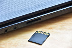 Sd card in slot with computer notebook. Stock Photography