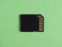 SD flash card over green Stock Photos