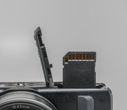 Memory Card in Camera. Memory card being inserted into a camera Royalty Free Stock Images