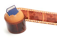 Sd memory card,egg-shell and film Royalty Free Stock Image