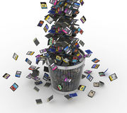 SD and microSD memory cards flow on trashcan Royalty Free Stock Image