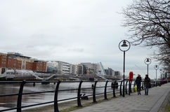 Seán O`Casey Bridge and Walk Path along The River Liffey in Dublin, Ireland Royalty Free Stock Photo