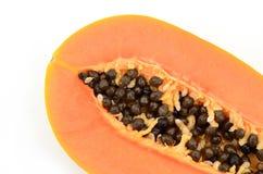 Seção do isolado do fruto da papaia no fundo branco Foto de Stock