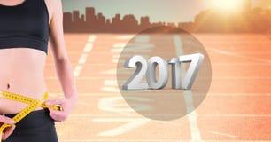 Seção meados de da mulher que mede sua cintura contra 3D 2017 Fotografia de Stock
