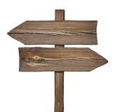 Señal de dirección de madera con dos flechas en direcciones opuestas Fotografía de archivo