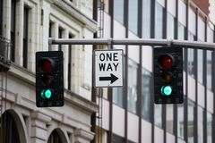 Señal de la placa de calle con la luz verde fotografía de archivo libre de regalías