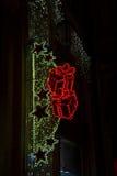 Señal de neón festiva encendida en la noche Fotos de archivo