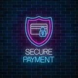 Señal de neón que brilla intensamente del pago seguro Símbolo de la protección del pago con el escudo y la tarjeta de crédito con imagen de archivo