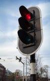 Señal de parada roja en el semáforo negro en Amsterdam Imágenes de archivo libres de regalías