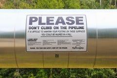 Señal de peligro de la seguridad de la tubería de Alaska - de Transporte-Alaska imagen de archivo