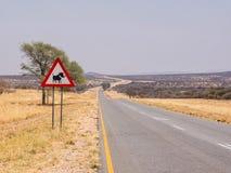 Señal de peligro del camino de la fauna Foto de archivo