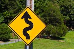 Señal de peligro del tráfico de las curvas Fotos de archivo libres de regalías