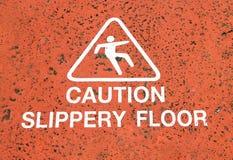 Señal de peligro en el piso Foto de archivo