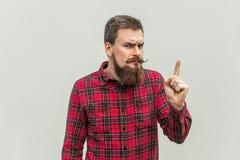 Señal de peligro Hombre de negocios adulto joven con la barba y el manillar m Imágenes de archivo libres de regalías