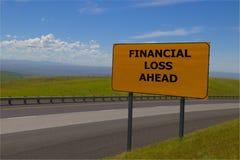 Señal de tráfico amarilla del ` de la pérdida financiera del ` a continuación foto de archivo libre de regalías