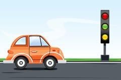 Señal de tráfico con el coche en el camino Imagen de archivo libre de regalías