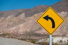 Señal de tráfico de la curva Fotografía de archivo