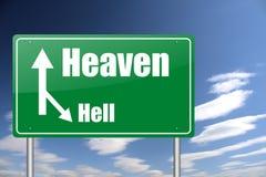 Señal de tráfico del cielo y del infierno Imagen de archivo libre de regalías