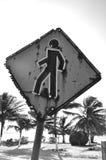 Señal de tráfico peatonal con los agujeros de bala Imagen de archivo libre de regalías