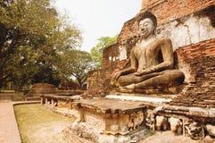 Señal religiosa asiática del arte - paredes del templo del ladrillo con el cuerpo de Buda Imágenes de archivo libres de regalías