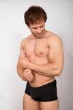 Señalar el bíceps Fotos de archivo libres de regalías