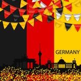 Señale los colores por medio de una bandera con el pequeño confeti de las banderas de los colores de Alemania Fotografía de archivo