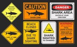 Señales de peligro del tiburón Fotografía de archivo libre de regalías