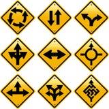 Señales de tráfico amarillas rombales con direcciones de las flechas Imagen de archivo