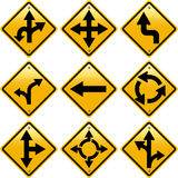 Señales de tráfico amarillas rombales con direcciones de las flechas Imágenes de archivo libres de regalías