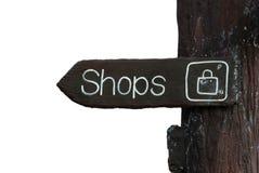 Señalización de madera que indica área de compras Fotografía de archivo