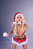 Señora atractiva Santa With Snow Imágenes de archivo libres de regalías