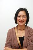 Señora china alegre Imagenes de archivo