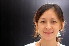 Señora china feliz Foto de archivo libre de regalías