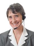 Señora con el receptor de cabeza Imagenes de archivo
