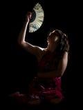 Señora con la pluma en noche Imágenes de archivo libres de regalías