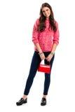 Señora con la sonrisa roja del bolso Imagen de archivo libre de regalías