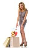 Señora con los bolsos de compras Foto de archivo libre de regalías
