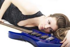 Señora con una guitarra Foto de archivo
