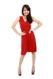 Señora de la belleza en la acción que lleva el vestido rojo Imagen de archivo libre de regalías