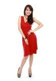 Señora de la belleza en la acción que lleva el vestido rojo Imagenes de archivo