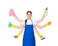 Señora de la limpieza hermosa con seis manos Imagen de archivo libre de regalías