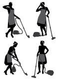 Señora de la limpieza With Vacuum Cleaner Imagenes de archivo