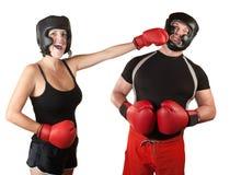 Señora de risa Boxer Punches Man Imágenes de archivo libres de regalías