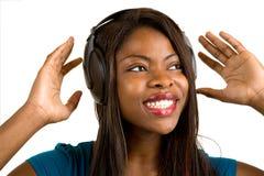 Señora del afroamericano con los auriculares Fotografía de archivo